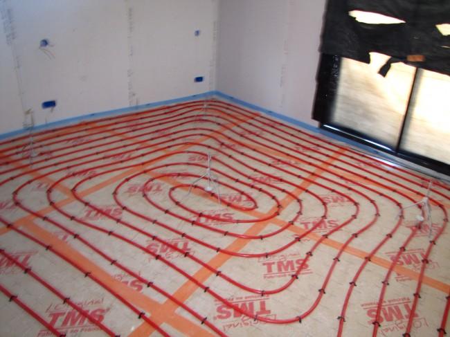 Réalisation plancher chauffant pompe à chaleur dans le Cantal